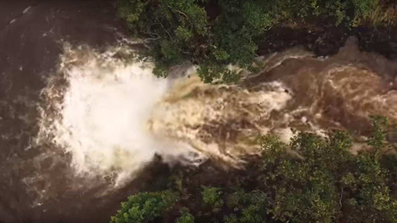Flash flood over waterfall