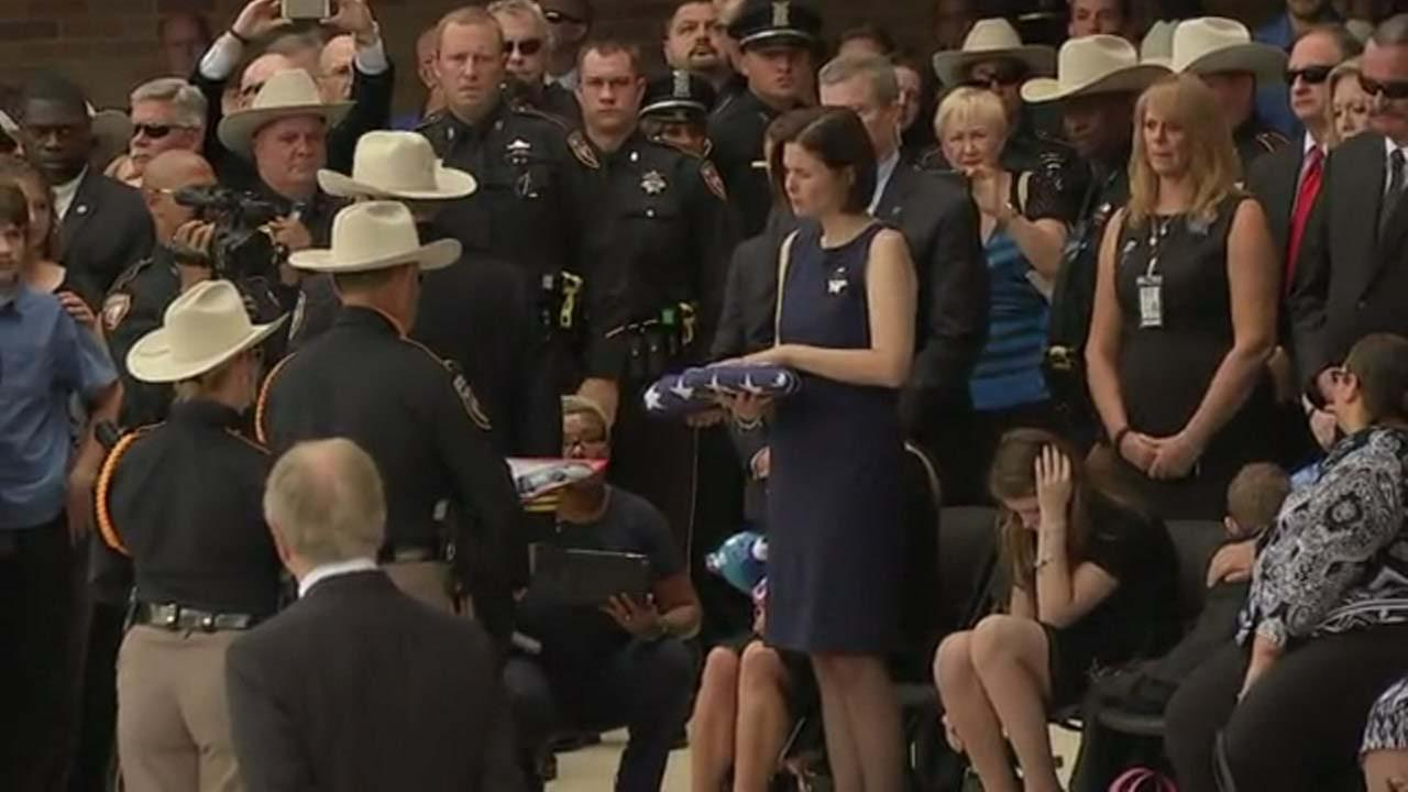 Kathleen Goforth receives an American flag in remembrance of her husband