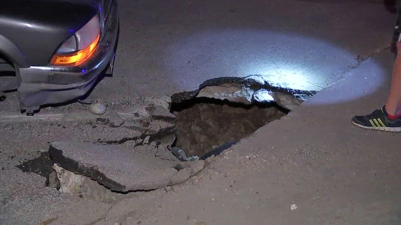 PHOTOS: Truck gets stuck in pothole