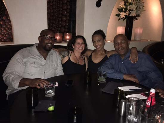 "<div class=""meta image-caption""><div class=""origin-logo origin-image none""><span>none</span></div><span class=""caption-text"">Gina Gaston with her husband, brother and sister-in-law</span></div>"
