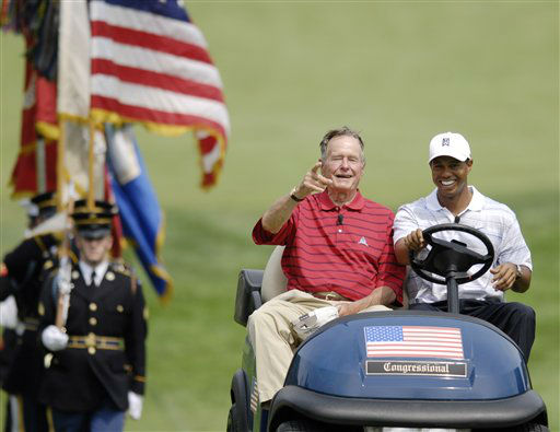 <div class='meta'><div class='origin-logo' data-origin='none'></div><span class='caption-text' data-credit='AP Photo/ Nick Wass'>Tiger Woods and former U.S. President George H.W. Bush ride in a golf cart towards the first tee for a ceremony during the AT&T Earl Woods Memorial Pro-Am, July 4, 2007.</span></div>