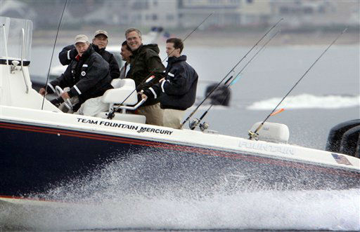 <div class='meta'><div class='origin-logo' data-origin='none'></div><span class='caption-text' data-credit='AP Photo/ Robert F. Bukaty'>Former President George H. W. Bush drives his speedboat while President Bush and his brother, Jeb Bush hold on during a fishing trip Aug. 10, 2007, off Kennebunkport, Maine.</span></div>