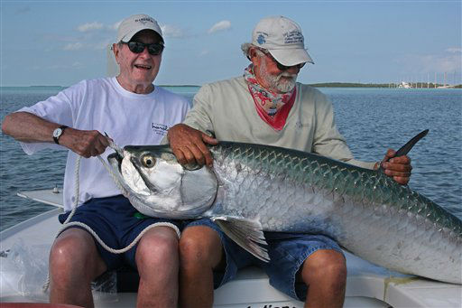 <div class='meta'><div class='origin-logo' data-origin='none'></div><span class='caption-text' data-credit='AP Photo/ Andy Mill'>Former President George H. W. Bush displays a tarpon he caught and released April 19, 2008, while fishing with George Wood off the Florida Keys.</span></div>