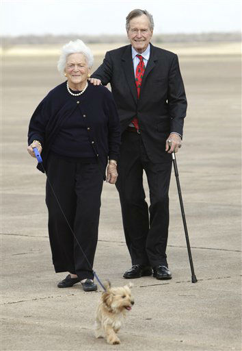 <div class='meta'><div class='origin-logo' data-origin='none'></div><span class='caption-text' data-credit='AP Photo/ Evan Vucci'>In this Friday, Dec. 26, 2008 file photo, former President George H.W. Bush, right, and Barbara Bush walk their dog after arriving aboard Air Force One,  in Waco, Texas.</span></div>