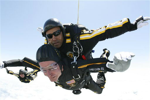<div class='meta'><div class='origin-logo' data-origin='none'></div><span class='caption-text' data-credit='AP Photo/ SSG Joe Abeln'>Former President George H. W. Bush rides tandem with Sgt. Michael Elliott of the Army Golden Knights parachute team as he celebrates his 85th birthday June 12, 2009.</span></div>