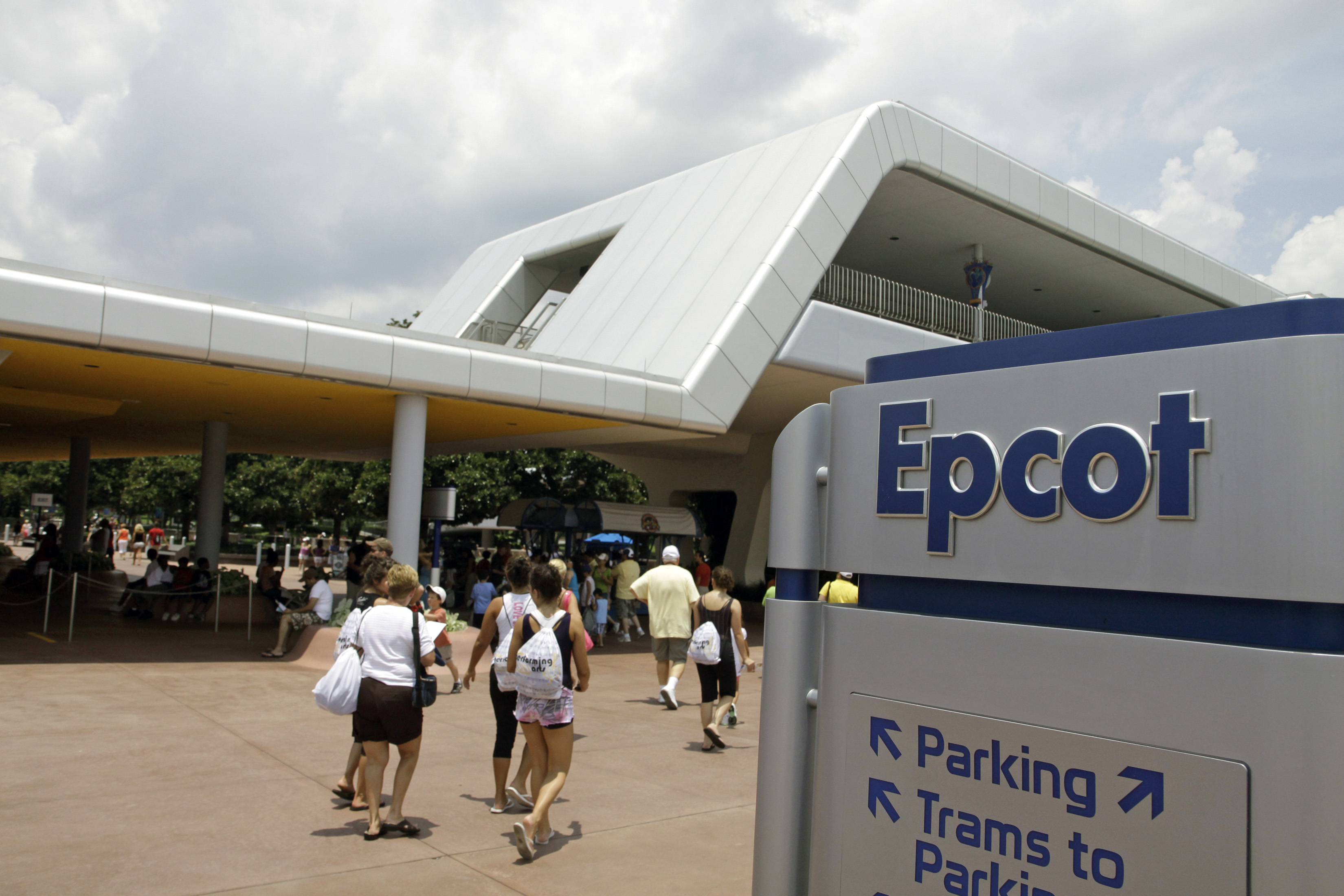 <div class='meta'><div class='origin-logo' data-origin='none'></div><span class='caption-text' data-credit='AP Photo/John Raoux'>Vistors exit the EPCOT theme park past the monorail station at Walt Disney World in Lake Buena Vista, Fla., in July 2009.</span></div>