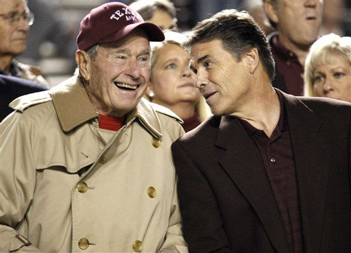 <div class='meta'><div class='origin-logo' data-origin='none'></div><span class='caption-text' data-credit='AP Photo/ David J. Phillip'>Texas Gov. Rick Perry talks with former President George H.W. Bush before an NCAA college football game between Texas and Texas A&M on Thursday, Nov. 26, 2009.</span></div>