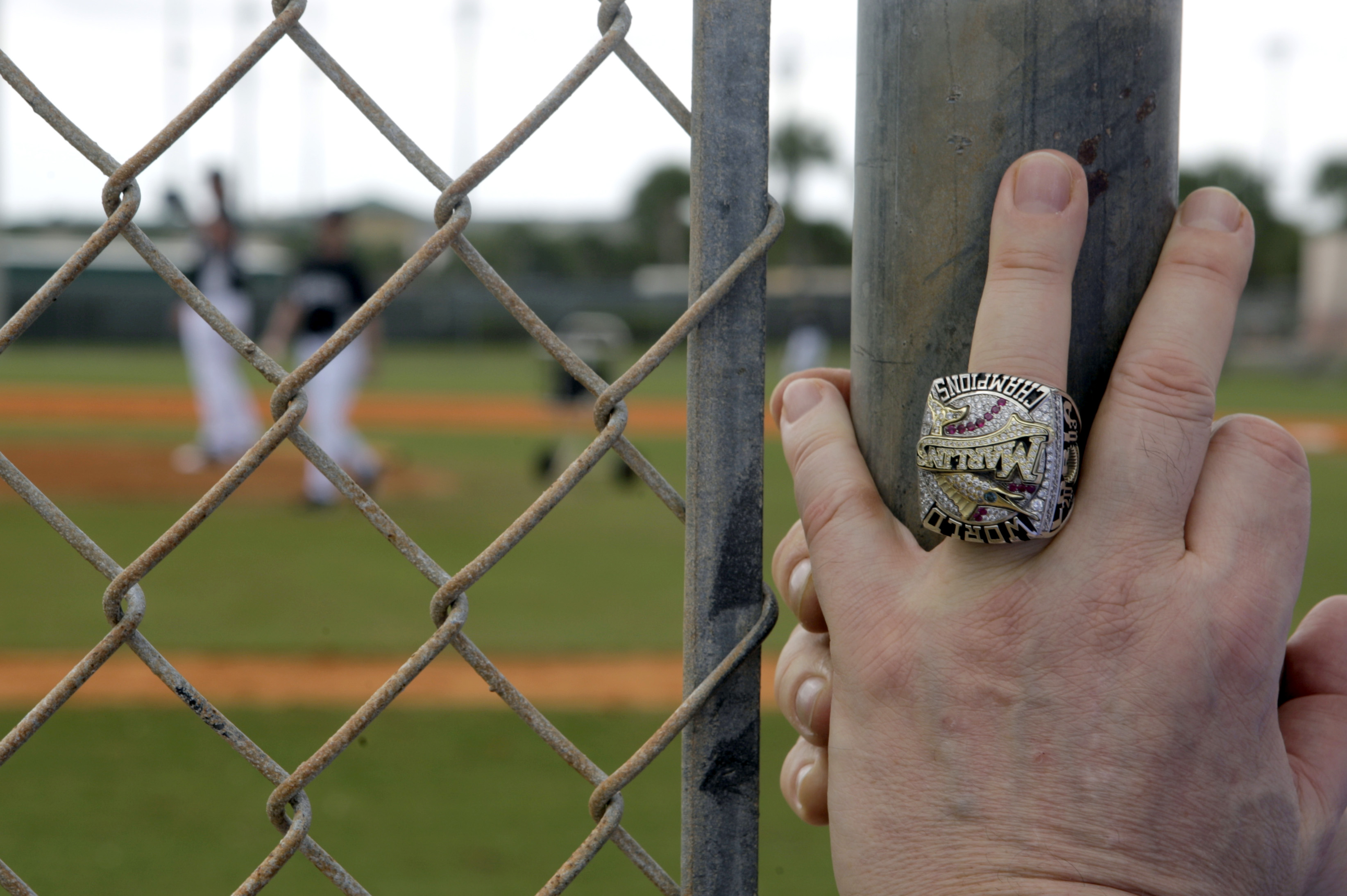 <div class='meta'><div class='origin-logo' data-origin='AP'></div><span class='caption-text' data-credit='AP Photo/Jeff Roberson'>Wearing his World Series ring, Florida Marlins owner Jeffrey Loria leans against a fence as he watches his team work out during spring training baseball Wednesday, Feb. 24, 2010.</span></div>
