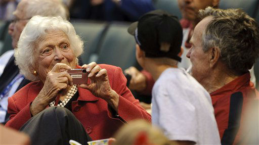 <div class='meta'><div class='origin-logo' data-origin='none'></div><span class='caption-text' data-credit='AP Photo/ Dave Einsel'>Barbara Bush takes a photograph of former U.S. president George H.W. Bush and a fan during an MLB baseball game April 9, 2010.</span></div>