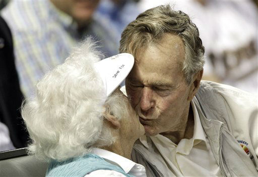 "<div class=""meta image-caption""><div class=""origin-logo origin-image none""><span>none</span></div><span class=""caption-text"">Former U.S. President George H.W. Bush kisses his wife, Barbara, after both were shown on the stadium kiss cam video board during a baseball game May 5, 2010, in Houston. (AP Photo/ David J. Phillip)</span></div>"