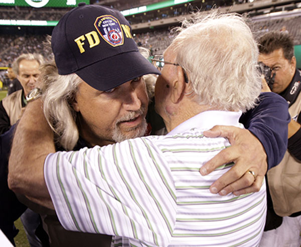 <div class='meta'><div class='origin-logo' data-origin='none'></div><span class='caption-text' data-credit='AP'>Dallas Cowboys defensive coordinator Rob Ryan, left, hugs his father Buddy Ryan Sunday, Sept. 11, 2011,  in East Rutherford, N.J. (AP Photo/Julio Cortez)</span></div>