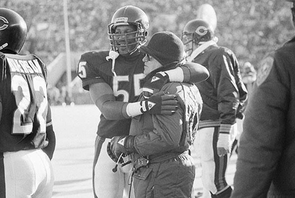 <div class='meta'><div class='origin-logo' data-origin='none'></div><span class='caption-text' data-credit='AP'>Buddy Ryan hugs linebacker Otis Wilson at the Bears game against the New York Giants, on Jan. 5, 1986. The Bears defense held the Giants 181 yards in the game.(AP Photo/John Swart)</span></div>