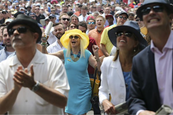 "<div class=""meta image-caption""><div class=""origin-logo origin-image none""><span>none</span></div><span class=""caption-text"">Horse racing fans react while watching a race before the 147th running of the Belmont Stakes horse race at Belmont Park, Saturday, June 6, 2015, in Elmont, N.Y.   (AP Photo/ Seth Wenig)</span></div>"