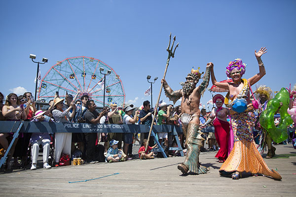 "<div class=""meta image-caption""><div class=""origin-logo origin-image ap""><span>AP</span></div><span class=""caption-text"">Participants march on the boardwalk during the 34th Annual Mermaid Parade, Saturday, June 18, 2016, in New York's Coney Island. (AP Photo/Mary Altaffer) (AP)</span></div>"