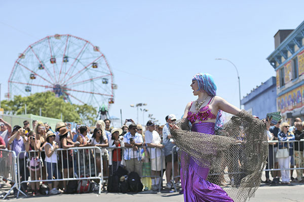 "<div class=""meta image-caption""><div class=""origin-logo origin-image ap""><span>AP</span></div><span class=""caption-text"">A participant marches on Surf Avenue past the Wonder Wheel during the 34th Annual Mermaid Parade, Saturday, June 18, 2016, in New York's Coney Island. (AP Photo/Mary Altaffer) (AP)</span></div>"