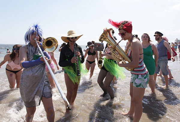 "<div class=""meta image-caption""><div class=""origin-logo origin-image ap""><span>AP</span></div><span class=""caption-text"">Members of the Brooklyn-based Rude Mechanical Orchestra Queer Solidarity Band entertain beach-goers after the parade  (AP Photo/Ezra Kaplan) (AP)</span></div>"