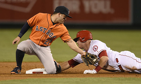 "<div class=""meta image-caption""><div class=""origin-logo origin-image ap""><span>AP</span></div><span class=""caption-text"">Los Angeles Angels' Mike Trout, right, steals second base ahead of the tag by Houston Astros second baseman Jose Altuve during the first inning of a baseball game in Anaheim, Calif (AP Photo/Kelvin Kuo)</span></div>"