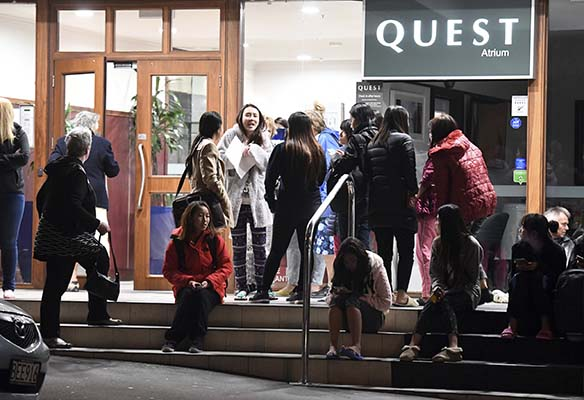 <div class='meta'><div class='origin-logo' data-origin='AP'></div><span class='caption-text' data-credit='Ross Setford/SNPA via AP'>People evacuated from the Quest On the Terrace Hotel gather outside the hotel in Wellington after a 6.6 earthquake based around Cheviol.</span></div>