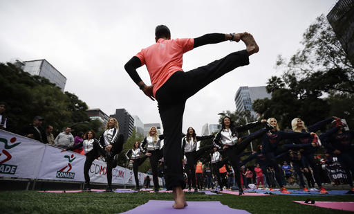 <div class='meta'><div class='origin-logo' data-origin='AP'></div><span class='caption-text' data-credit='AP Photo/Gregory Bull'>Oakland Raiders and Houston Texans cheerleaders follow a yoga instructor at the Angel of Independence monument during an NFL promotional event in Mexico City, Nov. 20, 2016.</span></div>