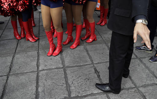 <div class='meta'><div class='origin-logo' data-origin='AP'></div><span class='caption-text' data-credit='AP Photo/Gregory Bull'>Houston Texans cheerleaders in red boots are directed to their performance area at the Angel of Independence monument in Mexico City, Sunday, Nov. 20, 2016.</span></div>