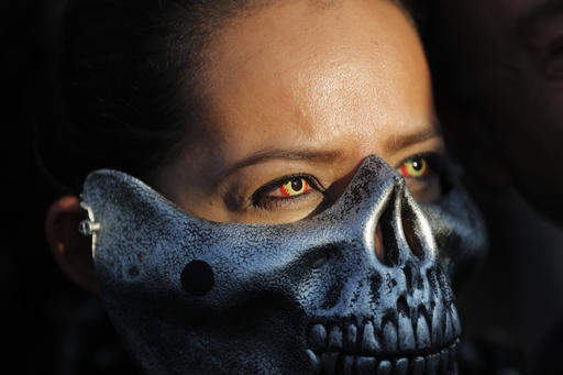 <div class='meta'><div class='origin-logo' data-origin='AP'></div><span class='caption-text' data-credit='AP Photo/Dario Lopez-Mills'>A dressed up Oakland Raiders fan poses for photos as she arrives at Azteca stadium in Mexico City, Monday, Nov. 21, 2016.</span></div>