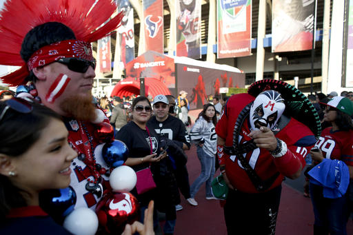 <div class='meta'><div class='origin-logo' data-origin='AP'></div><span class='caption-text' data-credit='AP Photo/Dario Lopez-Mills'>Fans for the Houston Texans and the Oakland Raiders arrive at Azteca Stadium before an NFL football game Monday, Nov. 21, 2016, in Mexico City.</span></div>