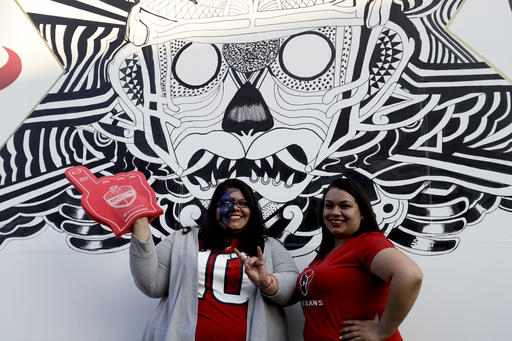 <div class='meta'><div class='origin-logo' data-origin='AP'></div><span class='caption-text' data-credit='AP Photo/Rebecca Blackwell'>Houston Texans fans pose for a picture outside of Azteca Stadium Monday, Nov. 21, 2016, in Mexico City.</span></div>
