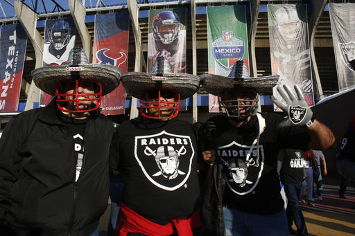 <div class='meta'><div class='origin-logo' data-origin='AP'></div><span class='caption-text' data-credit='AP Photo/Dario Lopez-Mills)'>Oakland Raiders fans pose for a picture in front of Azteca Stadium before an NFL football game against the Houston Texans Monday, Nov. 21, 2016, in Mexico City.</span></div>