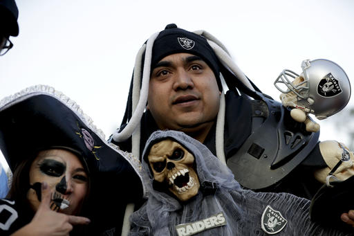 <div class='meta'><div class='origin-logo' data-origin='AP'></div><span class='caption-text' data-credit='AP Photo/Rebecca Blackwell'>Oakland Raiders fans arrive at Azteca Stadium before an NFL football game against the Houston Texans Monday, Nov. 21, 2016, in Mexico City.</span></div>