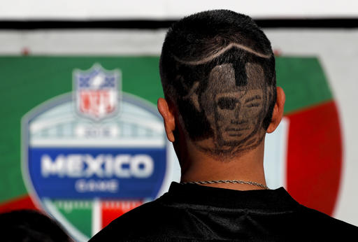 <div class='meta'><div class='origin-logo' data-origin='AP'></div><span class='caption-text' data-credit='AP Photo/Dario Lopez-Mills'>A Oakland Raiders fan arrives at Azteca Stadium before an NFL football game against the Houston Texans Monday, Nov. 21, 2016, in Mexico City.</span></div>