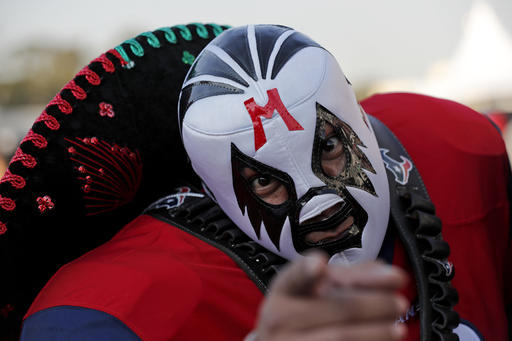 <div class='meta'><div class='origin-logo' data-origin='AP'></div><span class='caption-text' data-credit='AP Photo/Dario Lopez-Mills'>A Houston Texans fan poses before an NFL football game against the Oakland Raiders Monday, Nov. 21, 2016, in Mexico City.</span></div>