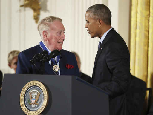 "<div class=""meta image-caption""><div class=""origin-logo origin-image ap""><span>AP</span></div><span class=""caption-text"">President Barack Obama presents the Presidential Medal of Freedom to sports broadcaster Vin ScullyTuesday, Nov. 22, 2016, in Washington. (AP Photo/Manuel Balce Ceneta) (AP)</span></div>"