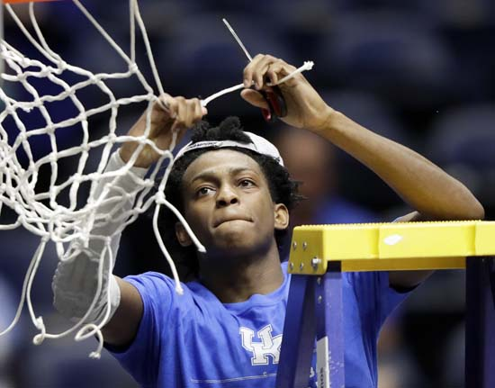 <div class='meta'><div class='origin-logo' data-origin='AP'></div><span class='caption-text' data-credit='AP'>Kentucky guard De'Aaron Fox cuts down the net after Kentucky beat Arkansas in an NCAA college basketball game for the championship of the SEC tournament. (AP Photo/Wade Payne)</span></div>