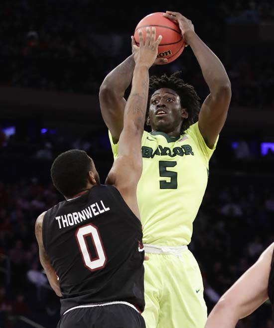 <div class='meta'><div class='origin-logo' data-origin='AP'></div><span class='caption-text' data-credit='AP'>Baylor forward Johnathan Motley (5) puts up a shot against South Carolina guard Sindarius Thornwell (0) in the first half. (AP Photo/Frank Franklin II)</span></div>