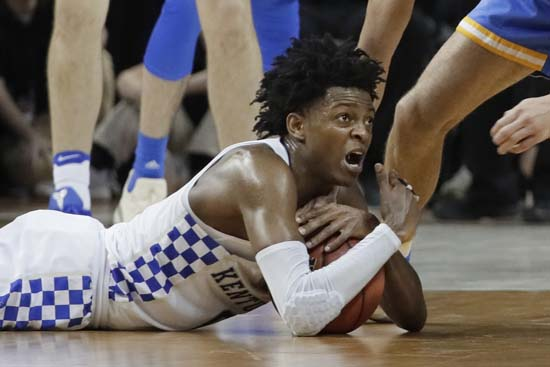 <div class='meta'><div class='origin-logo' data-origin='AP'></div><span class='caption-text' data-credit='AP'>Kentucky guard De'Aaron Fox guards the ball against UCLA in the second half. (AP Photo/Mark Humphrey)</span></div>