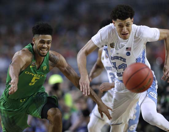 <div class='meta'><div class='origin-logo' data-origin='AP'></div><span class='caption-text' data-credit='AP'>Oregon guard Tyler Dorsey, left, fights for a loose ball with North Carolina forward Justin Jackson during the second half. (AP Photo/David J. Phillip)</span></div>