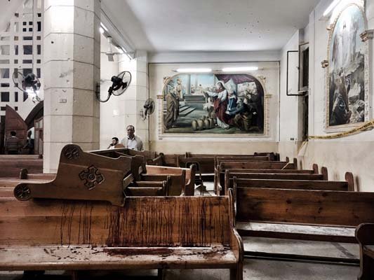 <div class='meta'><div class='origin-logo' data-origin='AP'></div><span class='caption-text' data-credit='AP'>Blood stains pews inside the St. George Church after a suicide bombing, in the Nile Delta town of Tanta, Egypt, Sunday, April 9, 2017. (AP Photo/Nariman El-Mofty)</span></div>