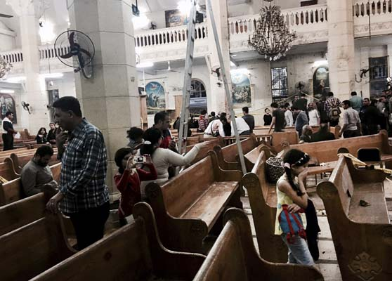 <div class='meta'><div class='origin-logo' data-origin='AP'></div><span class='caption-text' data-credit='AP'>People look at damage inside the St. George's after a suicide bombing, in the Nile Delta town of Tanta, Egypt, Sunday, April 9, 2017. (AP Photo/Nariman El-Mofty)</span></div>