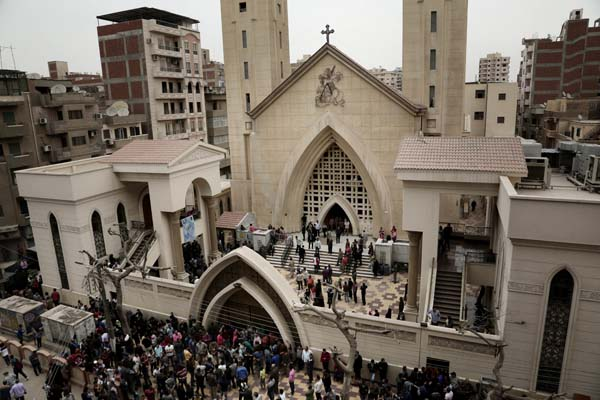 <div class='meta'><div class='origin-logo' data-origin='AP'></div><span class='caption-text' data-credit='AP'>People gather outside the St. George's Church after a deadly suicide bombing, in the Nile Delta town of Tanta, Egypt, Sunday, April 9, 2017. (AP Photo/Nariman El-Mofty)</span></div>