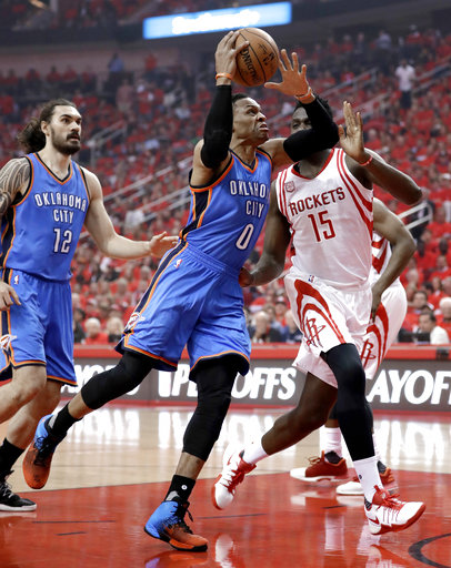 <div class='meta'><div class='origin-logo' data-origin='AP'></div><span class='caption-text' data-credit='AP'>Oklahoma City Thunder's Russell Westbrook (0) drives toward the basket as Houston Rockets' Clint Capela (15) defends during the first half in Game 5 (AP Photo/David J. Phillip)</span></div>