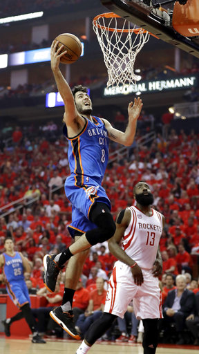 <div class='meta'><div class='origin-logo' data-origin='AP'></div><span class='caption-text' data-credit='AP'>Oklahoma City Thunder's Alex Abrines (8) goes up for a shot as Houston Rockets' James Harden (13) watches during the first half in Game 5 (AP Photo/David J. Phillip)</span></div>