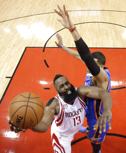 <div class='meta'><div class='origin-logo' data-origin='AP'></div><span class='caption-text' data-credit='AP'>Houston Rockets' James Harden (13) goes up for a shot as Oklahoma City Thunder's Andre Roberson defends during the first half in Game 5 (AP Photo/David J. Phillip)</span></div>