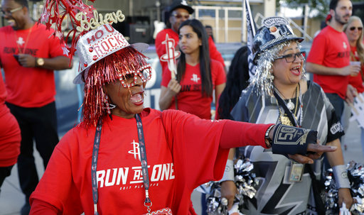 "<div class=""meta image-caption""><div class=""origin-logo origin-image ap""><span>AP</span></div><span class=""caption-text"">Houston Rockets fan Barbara Myers, left, and San Antonio Spurs fan Sovia Lauflano, right, dance in a fan area, Monday, May 1, 2017, in San Antonio. (AP Photo/Eric Gay) (AP)</span></div>"