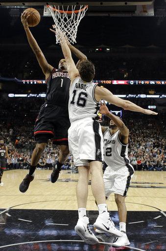 "<div class=""meta image-caption""><div class=""origin-logo origin-image ap""><span>AP</span></div><span class=""caption-text"">Houston Rockets forward Trevor Ariza (1) goes up for a shot as San Antonio Spurs' Pau Gasol (16) and LaMarcus Aldridge, right, defend during Game 2. (AP Photo/Eric Gay) (AP)</span></div>"