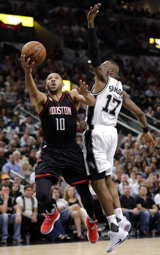 "<div class=""meta image-caption""><div class=""origin-logo origin-image ap""><span>AP</span></div><span class=""caption-text"">Houston Rockets guard Eric Gordon (10) leaps to the basket for a shot as San Antonio Spurs' Jonathon Simmons (17) defends during the first half of Game 2. (AP Photo/Eric Gay) (AP)</span></div>"