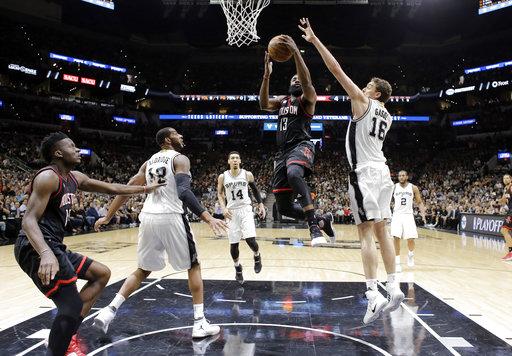"<div class=""meta image-caption""><div class=""origin-logo origin-image ap""><span>AP</span></div><span class=""caption-text"">Houston Rockets guard James Harden (13) goes up for a shot between San Antonio Spurs' LaMarcus Aldridge, left, Danny Green (14) and Pau Gasol (16). (AP Photo/Eric Gay) (AP)</span></div>"