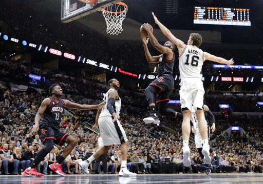 """<div class=""""meta image-caption""""><div class=""""origin-logo origin-image ap""""><span>AP</span></div><span class=""""caption-text"""">Houston Rockets' Clint Capela (15) and San Antonio Spurs' LaMarcus Aldridge, second from left, watch as James Harden (13) goes up for a shot past Pau Gasol (16) (AP Photo/Eric Gay) (AP)</span></div>"""