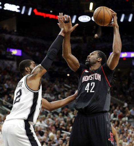 """<div class=""""meta image-caption""""><div class=""""origin-logo origin-image ap""""><span>AP</span></div><span class=""""caption-text"""">San Antonio Spurs' LaMarcus Aldridge (12) guards against a shot by Houston Rockets' Nene Hilario (42)  (AP Photo/Eric Gay) (AP)</span></div>"""