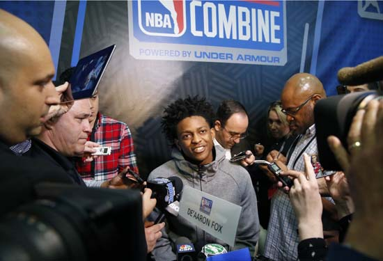 <div class='meta'><div class='origin-logo' data-origin='AP'></div><span class='caption-text' data-credit='AP'>De'Aaron Fox, center, from Kentucky, listens to a question at the NBA draft basketball combine Friday, May 12, 2017, in Chicago. (AP Photo/Charles Rex Arbogast)</span></div>