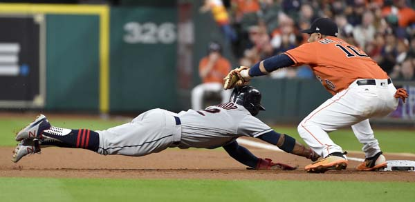 "<div class=""meta image-caption""><div class=""origin-logo origin-image ap""><span>AP</span></div><span class=""caption-text"">Cleveland Indians' Francisco Lindor, left, is picked off by Houston Astros first baseman Yuli Gurriel during the first inning of a baseball game,  (AP Photo/Eric Christian Smith) (AP)</span></div>"